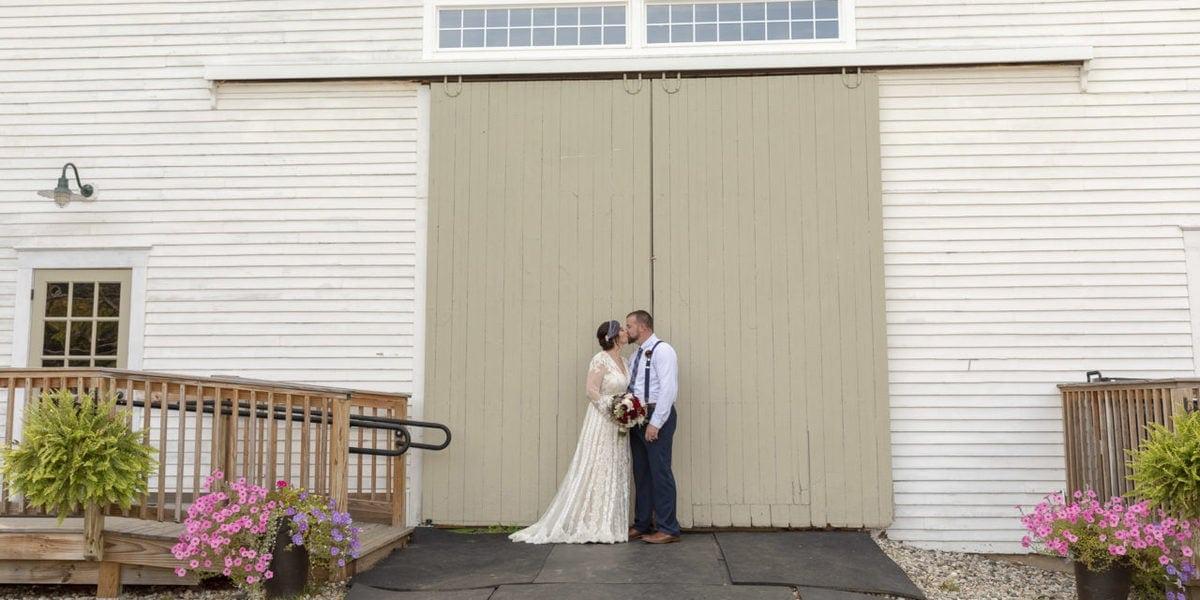 Inn at Fogg Farm Wedding Gray Maine Bride and Groom in front of Barn Door