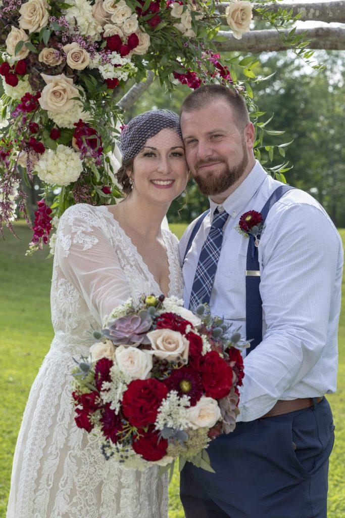 Bride and Groom Posing Under Arbor Inn at Fogg Farm Gray Maine Wedding